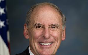 Американский политик, член Республиканской партии, сенатор США от штата Индиана (1989—1999, 2011—2017), кандидат на должность директора Национальной разведки