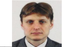 Офицер Федеральной службы безопасности России, но его ранг неизвестен. также предполагается, что он занимал должность начальника Отдела по информационной безопасности в одной российской компании и предоставлял ФСБ информацию о сотрудниках этой компании. (Подозревается в массовой кибератаке против Yahoo в 2014 году)