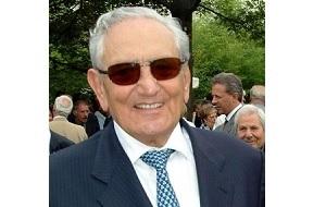 Итальянский бизнесмен, владелец компании Ferrero, производящей шоколад и другие кондитерские изделия. Являлся самым богатым человеком Италии по версии журнала Forbes с состоянием 17 миллиардов долларов США.
